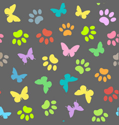 Colored butterflies and pawprints seamless pattern vector