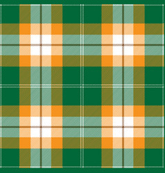 Green and orange tartan plaid seamless pattern vector