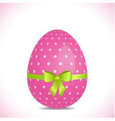 pink polka dot easter egg with green ribbon vector image vector image