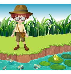 A serious looking boy at the riverbank vector image