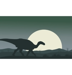 Silhouette of iguanodon with moon vector