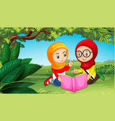 two muslim girls reading book in park vector image