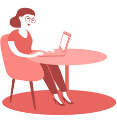 young woman sitting at his desk using laptop vector image