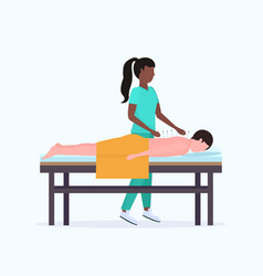 African american acupuncturist holding needle man vector