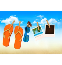 Flip flops sunglasses and photo cards hanging on a vector image