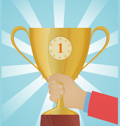 golden cup in hand trophy vector image