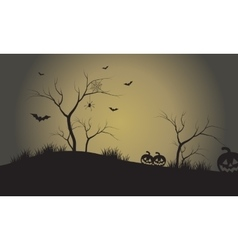 Silhouette of pumpkins and bat at afternoon vector
