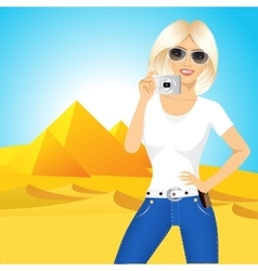 woman taking a picture in egypt vector image