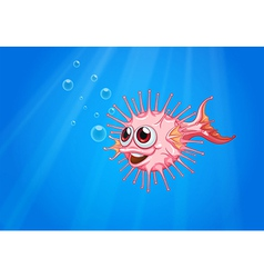 A pink puffer fish in the ocean vector