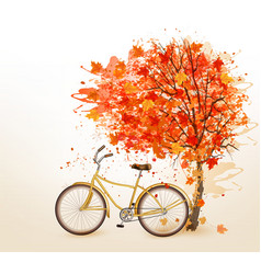 Autumn tree background with a yellow bicycle vector