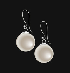 realistic pearl earrings isolated on black vector image