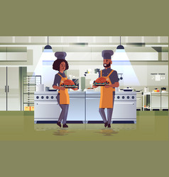 Professional chefs couple holding trays vector