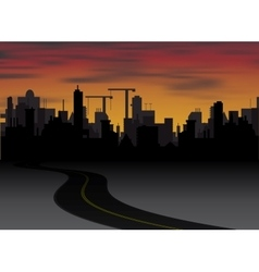 Silhouette of town with sunset and clouds in sky vector
