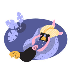 Woman sitting on cozy beanbag with tablet and cat vector