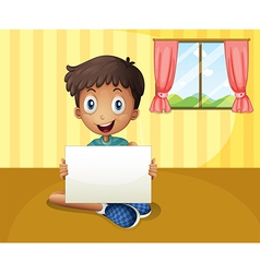 A boy sitting at the floor with an empty signboard vector image