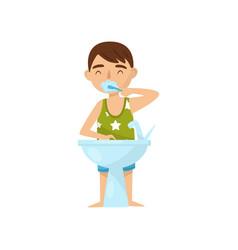 cute boy brushing his teeth in bathroom after or vector image
