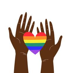 Two black hands holding lgbtq rainbow heart vector