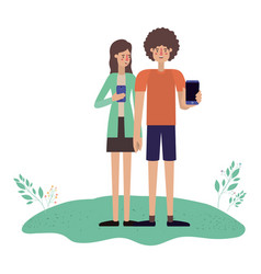 young couple using smartphone in grass vector image