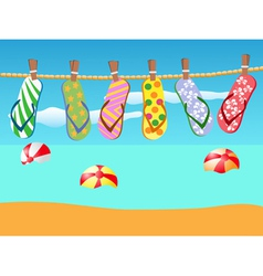 Beach sandals hanged on a rope vector image