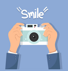 hand holding camera with smile vector image