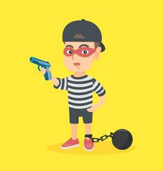 Caucasian criminal boy holding a gun vector