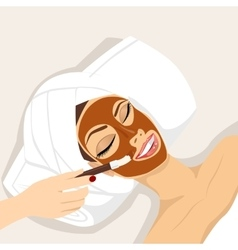 Woman having chocolate mask treatment therapy vector