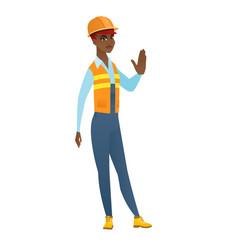 African-american builder showing stop hand gesture vector