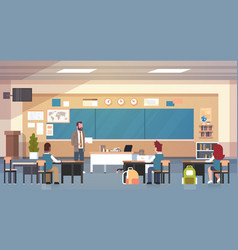 Male teacher and pupils in classroom on lesson vector