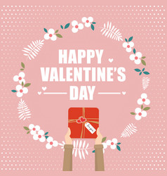 hand holding gift box for valentines day vector image vector image