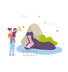 mother and son feeding a hippo in zoo park vector image