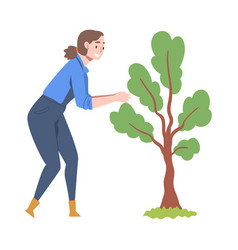 Young woman in rubber garden boots caring tree vector