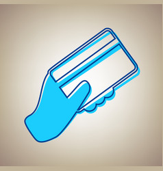Hand holding a credit card sky blue icon vector