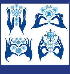 snowflake icons with hands vector image