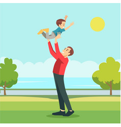 Proud father playing with his son in garden vector