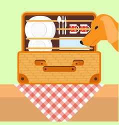 Open basket for a picnic with tableware dog vector