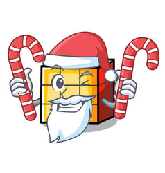 Santa with candy rubik cube mascot cartoon vector