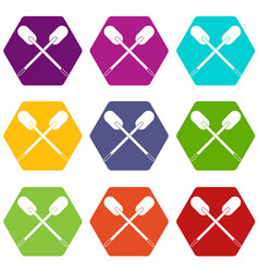 Two wooden crossed oars icon set color hexahedron vector