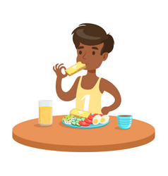 cute boy having breakfast in the kitchen colorful vector image