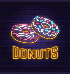 neon donuts retro sign on brick wall background vector image
