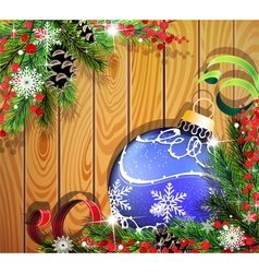 Blue Christmas ball on wooden background vector