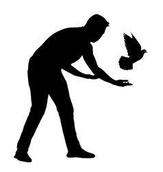Silhouette of the guy lets go of the dove into vector