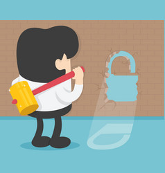 Young businessman with big hammer against wall vector