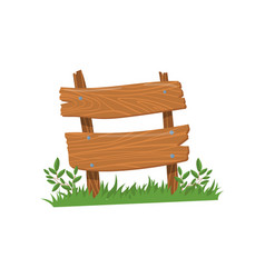 old wooden road sign standing on the grass wood vector image