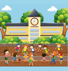 Children playing soccer on field vector