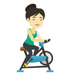 Young woman riding stationary bicycle vector