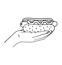 hand holding hot dog black and white vector image
