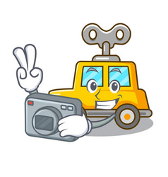 Photographer cartoon clockwork toy car for gift vector