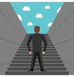 Ambitious businessman climbing steps vector