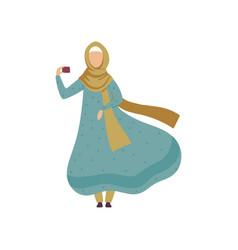 muslim woman taking selfie with mobile phone vector image