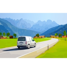 White car traveling on Alps vector image